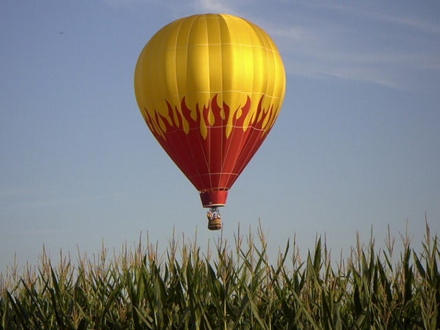 Float high above the trees in a Hot Air Balloon at Balloons Aloft, Inc.