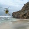 Starr_060228-6424_Yellow_helicopter_landing_on_Moku_Manu.jpg