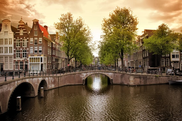Combine dining & sightseeing on Amsterdam's beautiful illuminated canals