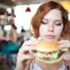 beauty woman in cafe eating hamburger.jpg