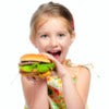 Pretty little girl eating a sandwich isolated on white background.jpg