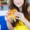 Portrait of an attractive young female having hamburger..jpg