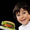 Kid serving burger.jpg