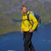 Young active man with backpack hiking on Lofoten islands in Norway.jpg