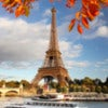 Eiffel Tower with autumn leaves in Paris, France.jpg