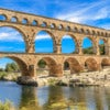 Pont du Gard is an old Roman aqueduct near Nimes in Southern France.jpg