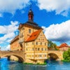 Scenic summer view of the Old Town architecture with City Hall building in Bamberg, Germany.jpg