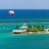 Para sailing over the tropical island of Ocho Rios, Jamaica..jpg