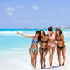 Group of friends having fun, walking at the paradise beach of Cancun.jpg