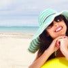Woman relaxing on the beach. Tropical resort..jpg