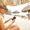 Woman with a smartphone on the beach. Vacation..jpg