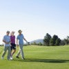 Three young golfers walking on golf course.jpg