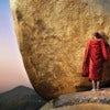 burma_kyaiktiyo-golden-rock_monk-red-robe-touching-rock.jpg