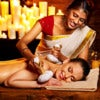 Woman having ayurvedic massage with pouch of rice..jpg