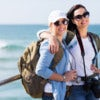 two pretty female tourists standing on beach pier.jpg