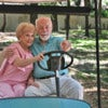 An active senior couple sightseeing in a golf cart..jpg