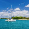 Catamaran Anchored in Turquoise Water and Blue Sky.jpg