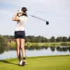 Girl golf player with driver teeing-off from tee-box.jpg