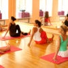 Women practicing yoga at health club.jpg