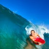 Boogie boarder surfing a wave, riding in the tube or barrel.jpg
