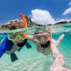 Split photo of mother and son family snorkeling in turquoise ocean water at tropical island.jpg