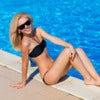 young woman in swimwear by the pool.jpg