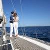 Fancy couple enjoying sailing on a beautiful sailboat.jpg