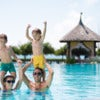 Cheerful family spending time in the swimming pool.jpg