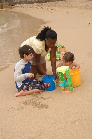 FDR vacation nanny on the beach with 2 small children